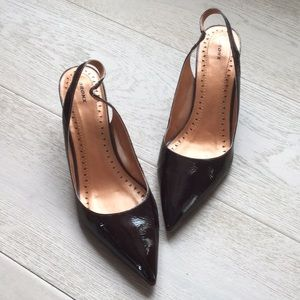 Brown patent leather heels.